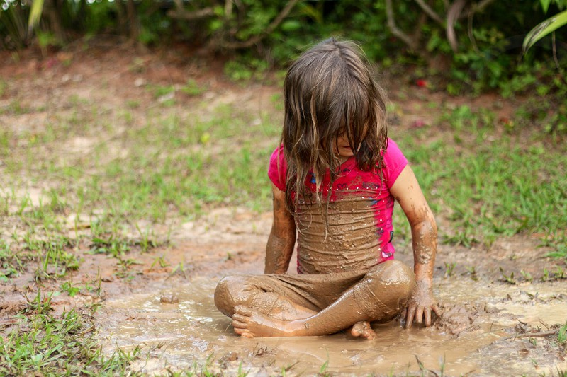 girl playing in mud photo