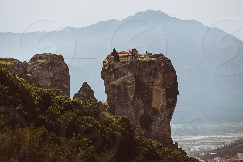 meteora greece europe monastery monk rock church architecture landscape orthodox mountain risk valley day photo