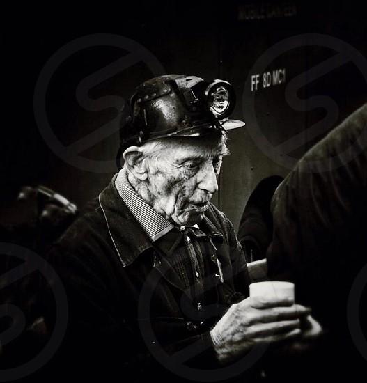 Old miner taking a tea break photo