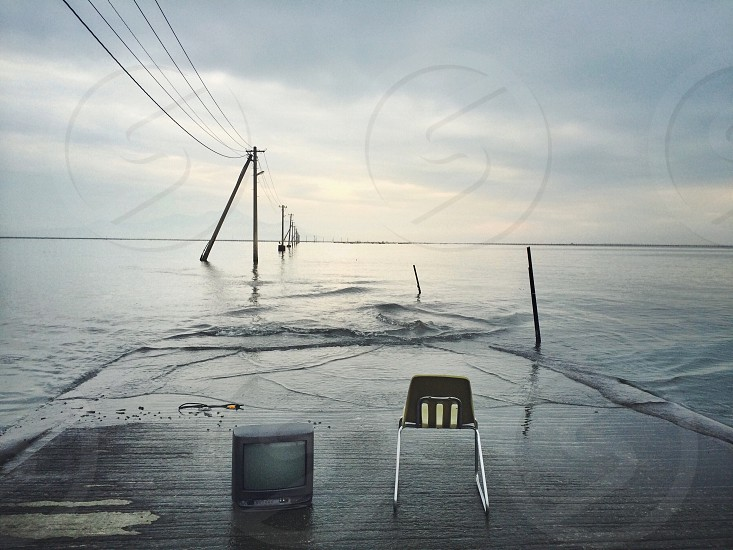 black crt television on the seashore photo
