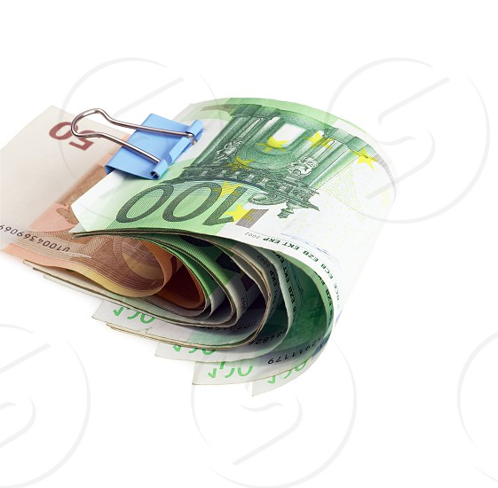 euro bills with paper clip on white background photo