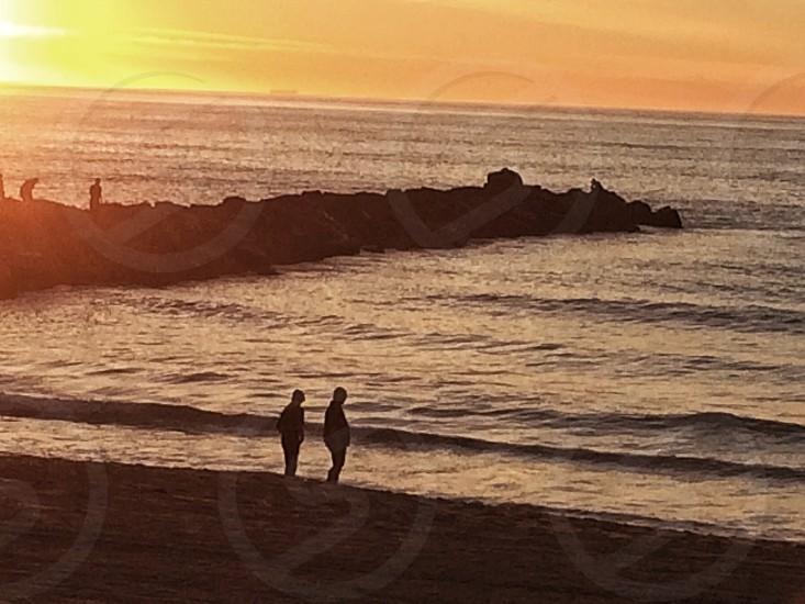 Lovers beach walk beach ocean pacific couple California. Summer  photo
