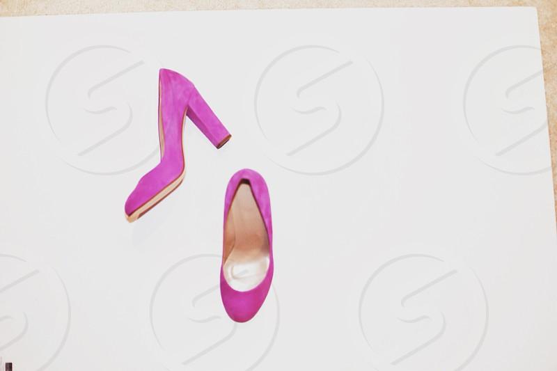 orange chunky heeled pumps on floor photo