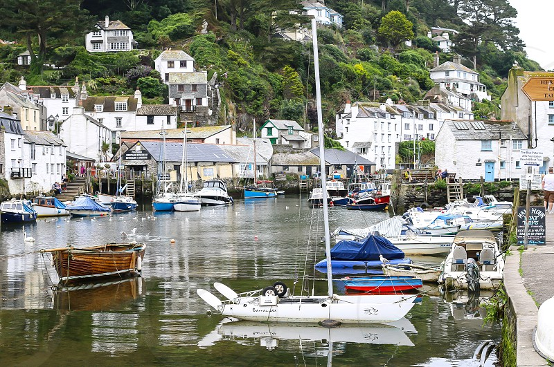 The still calm of the harbour and port at Polperro the small Cornish fishing village photo