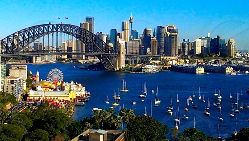 Sydney Harbour. City scape. Ocean. Tall buildings. Boats. Piers. photo