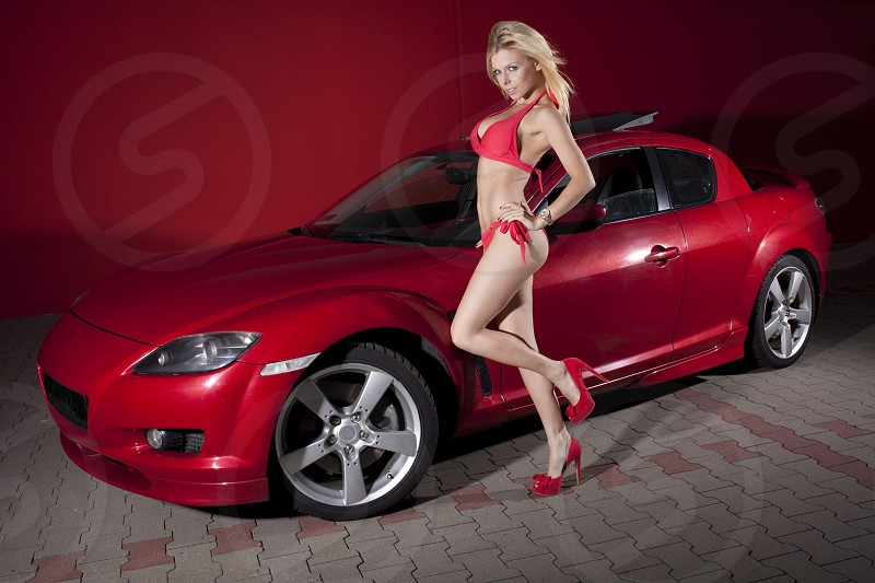 Sexy girl with sport car. photo
