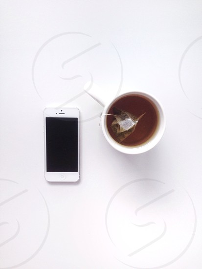 Simple phone and tea.  photo