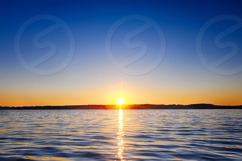 Sunset over a lake photo