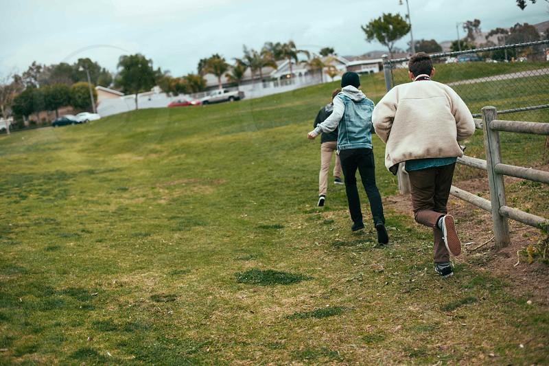 3 person running photo