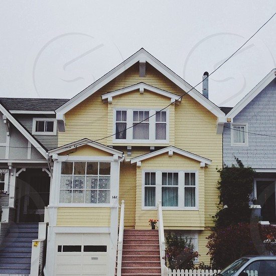 yellow two storey house photo