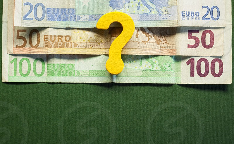 Conceptual image about euro devaluation euro banknotes in upper half empty down half green background.  photo