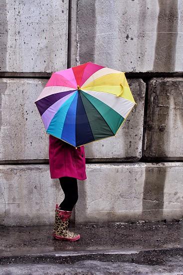 Umbrella rainbow bright colorful rain child wet boots photo