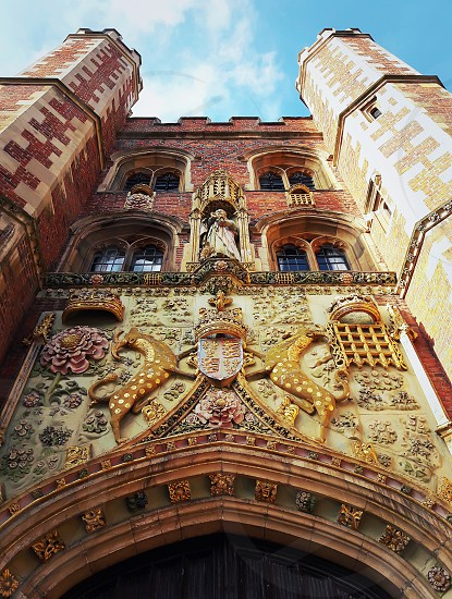 The decorated facade of the gatehouse at St Johns College in Cambridge UK. photo