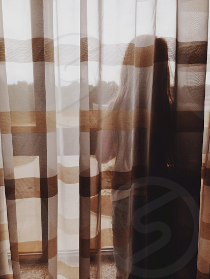 see through brown striped window curtains photo