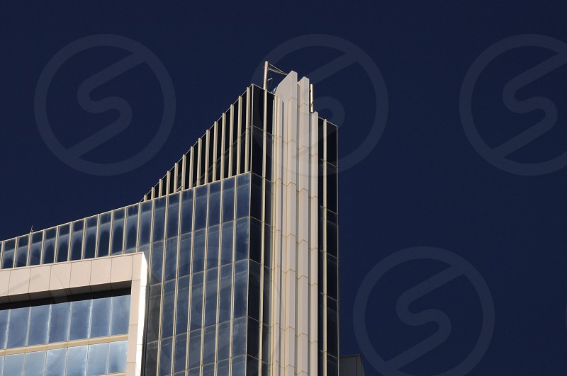 worm's eye view of high rise building under clear blue sky photo