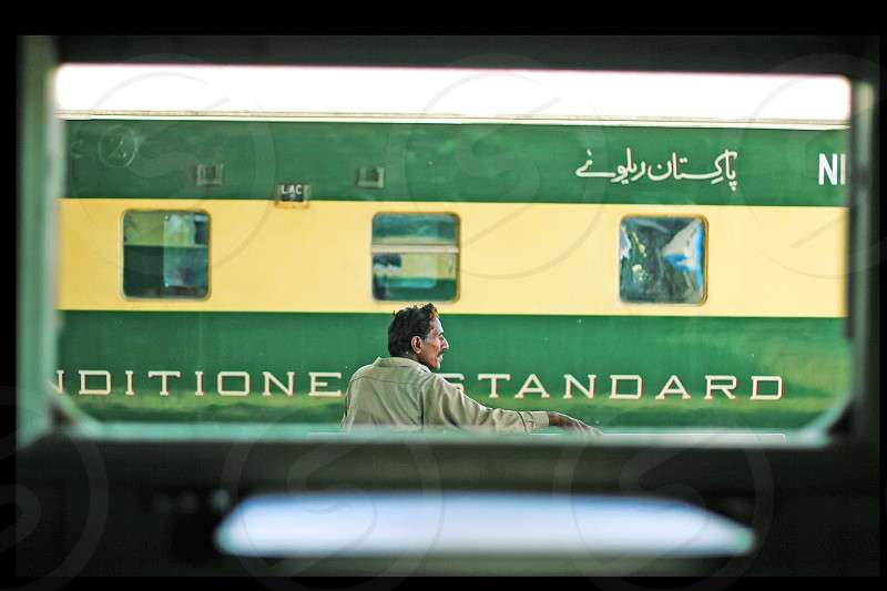 Passenger sitting on a bench and waiting for train at Karachi Cantt Station - 17-03-2013 photo