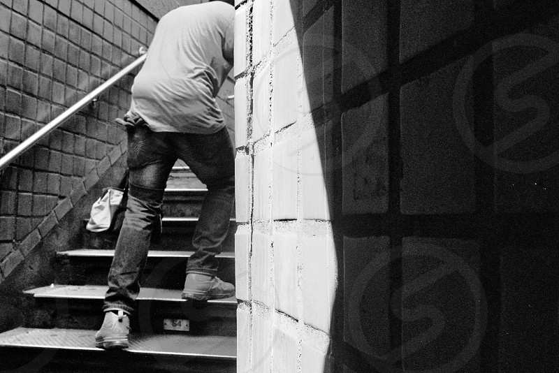 man new york manhattan subway underground worker limp photo