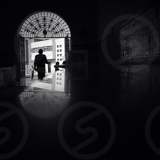 silhouette near door photo