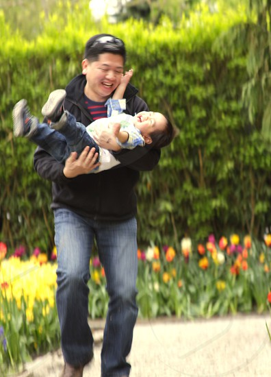 man carrying son photo