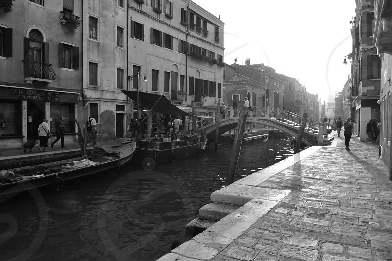 Venice black white love city river water Gondola brick boat boats Venetian building bridge market steps window people shadows sun daylight day sunspot photo