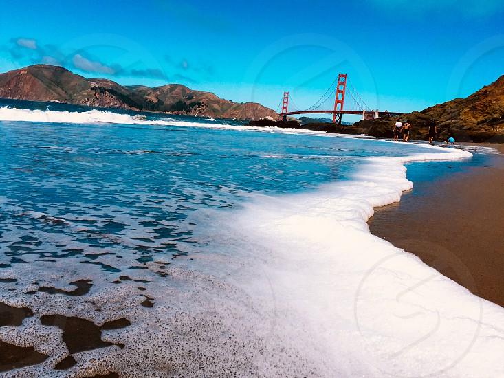 Baker Beach San Francisco Bay Area Northern California USA beach sand Golden Gate Bridge waves water foam  photo