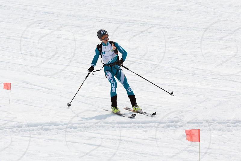 AVACHA KORYAK VOLCANOES KAMCHATKA RUSSIA - APRIL 27 2014: Ski mountaineer Konstantin Savchuk rides from Avacha Volcano. Team Race ski mountaineering Asian ISMF Russian Kamchatka Championship. photo