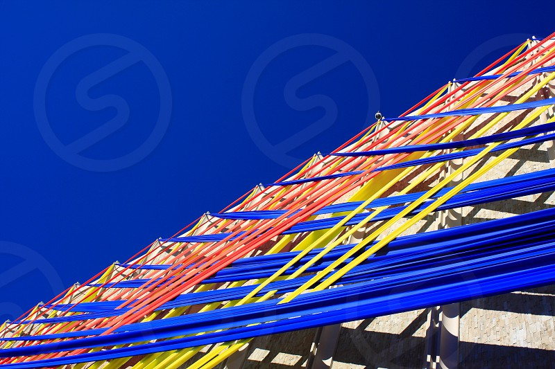 A building wrapped with colorful ribbons photo