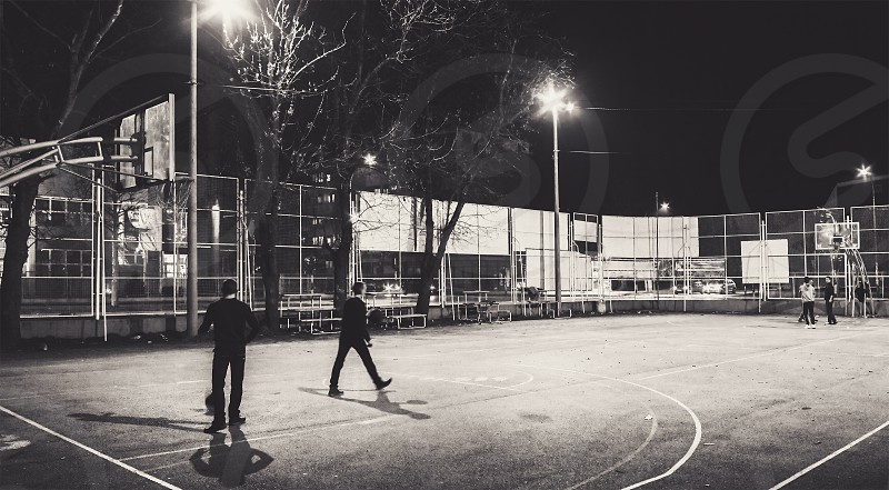 Cacak town in Serbia cinematic view of the basketball court during night. photo
