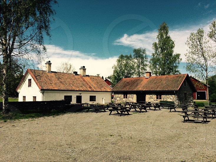 Old 1800s buildings become in an active restaurant in midsummer at Langvindsbruk Sweden. photo