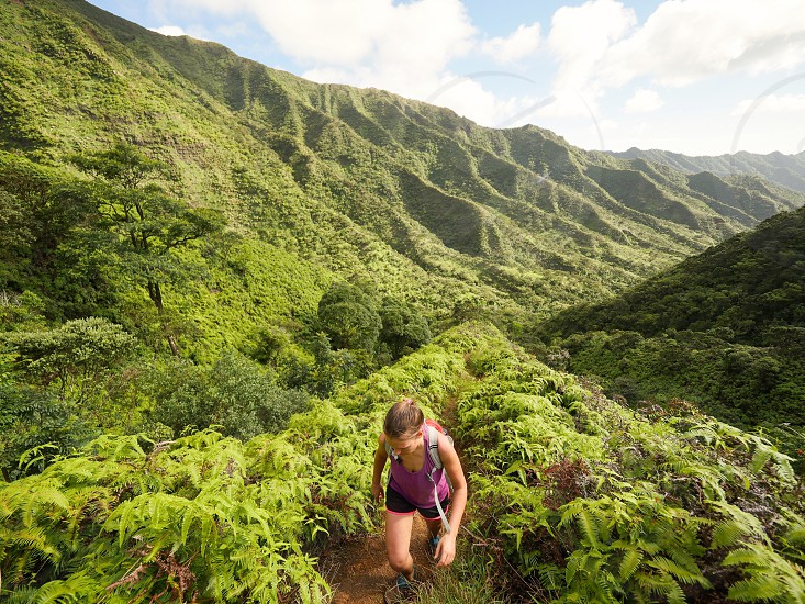 Woman hiking in the nature environment of Hawaii lifestyle outdoors  photo