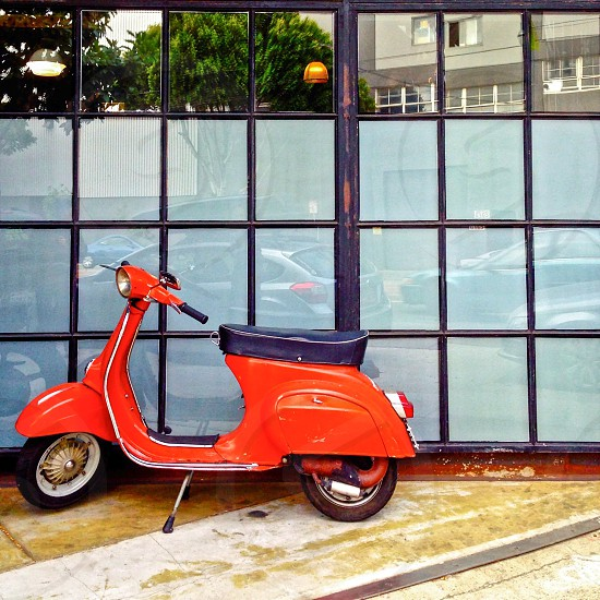 Red scooter Vespa  photo