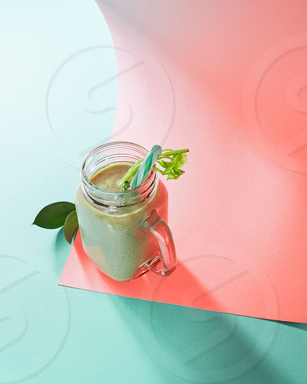 Natural ingredients for healthy smoothie from vegetables in glass jar on a duotone background in color of the year 2019 Living Coral Pantone. Concept of vegan and healthy eating. photo