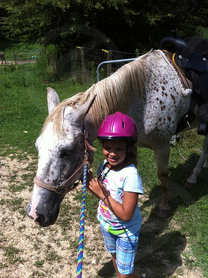 Horses Horse Riding 8 year old girl  photo
