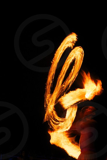 time lapse photography of man doing fire dance photo