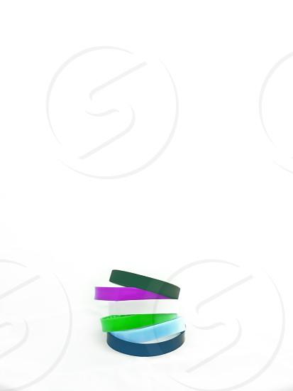 Stack of rubber band bracelets 1 photo