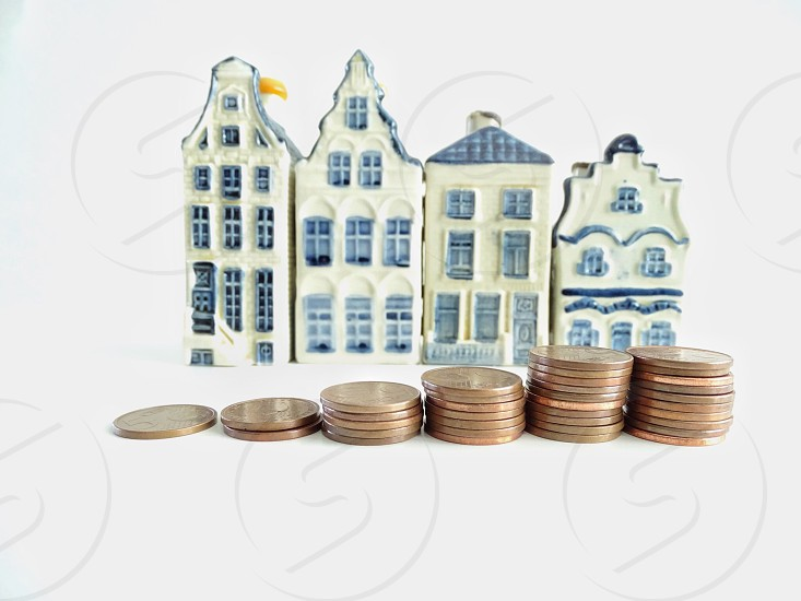 Stack coins human hand counting finance banking currency money trade economy savings candl houses loan dutch  photo