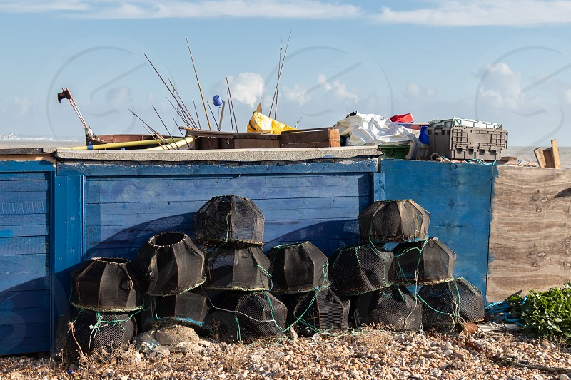 WORTHING WEST SUSSEX/UK - NOVEMBER 13 : View of some lobster pots on the beach in Worthing West Sussex on November 13 2018 photo