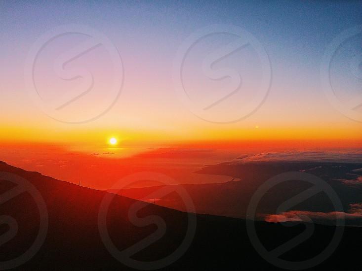 sunset over mountain landscape photo