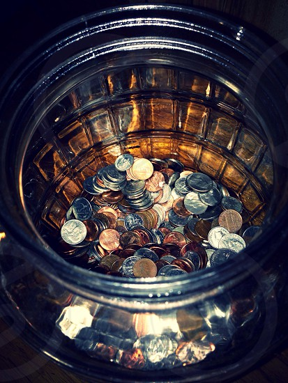 coins on a glass container photo