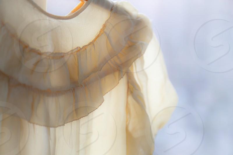 Soft yellow childrens silkdress photo