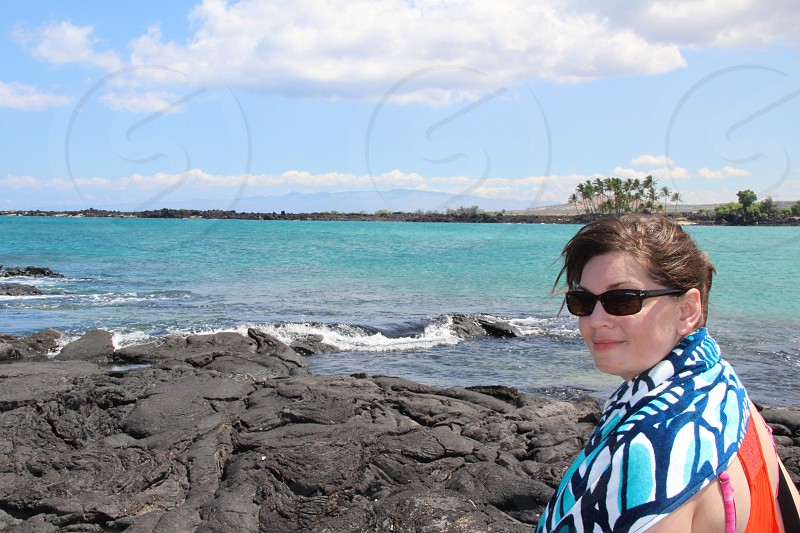 woman in black sunglasses near the sea photo