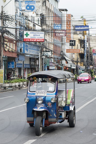 a Tuk Tuk Taxi in Banglamphu in the city of Bangkok in Thailand in Southeastasia.  Thailand Bangkok November 2018 photo