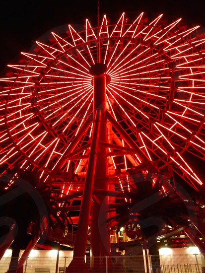 red LED light ferris wheel at nighttime photo