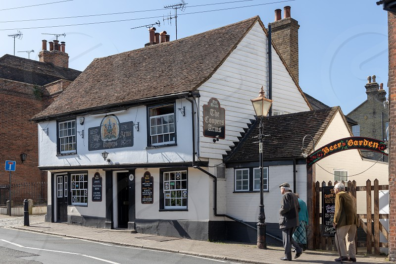 ROCHESTER KENT/UK - MARCH 24 : View of the Coopers Arms public house in Rochester on March 24 2019. Three unidentified people photo
