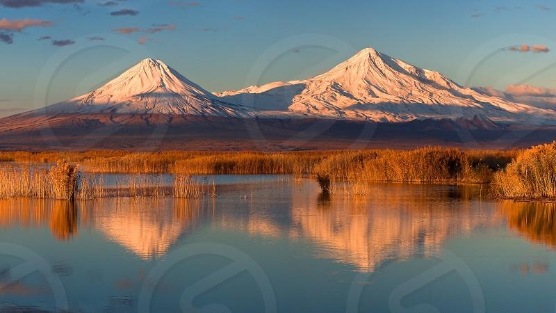 Armenia Ararat Masis Mt. Ararat mountains reflection autumn snow peak water mirror lake Bible mountain blue orange white reed photo