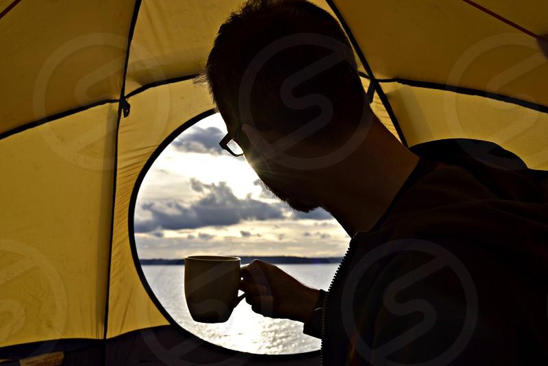 Travel freedom tent man coffee morning sunrise. photo