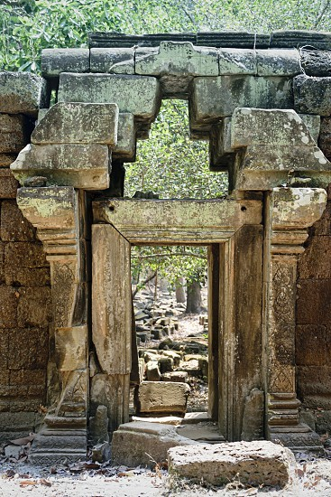 Angkor Thom Cambodia March 2016: Minor structures in the  gardens around the  Baphuon temple mountain. reconstructed by archaeologists over 16 years following the khmer rouge conflict photo