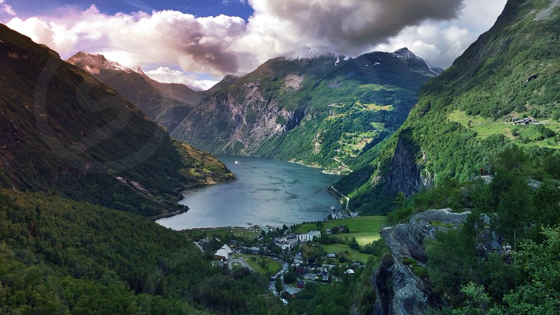 Sunset at Geiranger Fjord Lake. Nature village hill cliff norway geiranger sunset sunrise photo