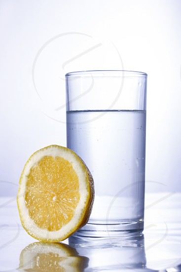 Photo of a glass of water and a slice of lemon photo