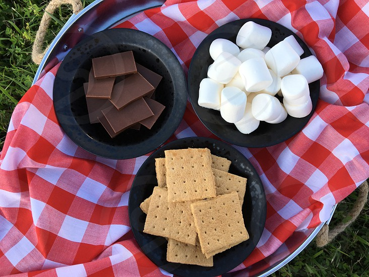 Snack food of graham crackers marshmallows and chocolate for s'mores photo